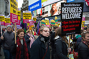 Demonstrators with Refugees Welcome placards pass through Piccadilly shouting at members of a far right movement at Anti-racism Day demonstration led by Stand Up To Racism on 19th March 2016 in London, United Kingdom. Stand Up To Racism has led some of the biggest anti-racist mobilisations in Britain of the last decade, making a stand protesting against racism, Islamophobia, anti-Semitism and fascism.