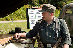 Reenactor from the Northern World War Two Association portraying a German soldier of the 21st Panzer Division with an MP40 Machine Pistol takes part in the Leigh Armed Forces Day 26 June 2010 Images © Paul David Drabble.