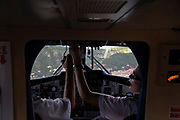 Pilots in airplane cockpit before tricky landing on St. Barthelemy, FWI