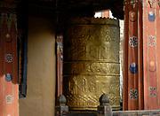 Prayerwheel in the National Museum of Bhutan in the watch tower of Paro Dzong.  Paro, Druk Yul, Bhutan. 10 November 2007.