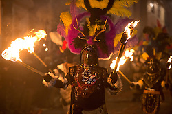 """© London News Pictures. 05/11/2013 . Lewes, UK. Bonfire societies parade through the streets of Lewes, East Sussex, during the traditional bonfire night celebrations. Thousands of people line the narrow streets to watch as bonfire societies parade in costume with the evening ending in the burning of the """"guy"""". Bonfire Night marks the date of the uncovering of the Gunpowder Plot in 1605 and commemorates the memory of the seventeen Protestant martyrs. Photo credit : Ben Cawthra/LNP"""