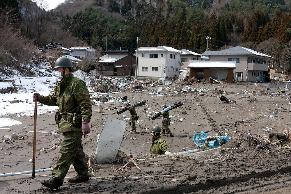 Members of the Japanese Self Defence Force begin recovery operations after the tsunami that struck the north east coast of Japan on March 11th in Otsuchi, Iwate, Japan. March 17th 2011