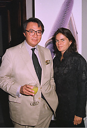 MR DAVID TANG the multi millionaire Hong Kong businessman and his fiance MISS LUCY WASTNAGE, at a party in London on 17th September 1997. MBG 4