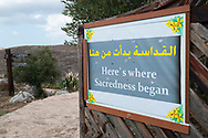 """A sign in Qana, Lebanon says, """"Here's where Sacredness began"""". This is the place where many believe that Jesus performed his first miracle, changing water to wine at a wedding party."""