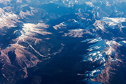 Aerial view of rocky mountains covered with snow