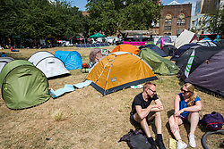 London, UK. 16 July, 2019. Climate activists from Extinction Rebellion relax and prepare for actions at their camp on Waterloo Millennium Green on the second day of their 'Summer uprising', a series of events intended to apply pressure on local and central government to address the climate and biodiversity crisis. Credit: Mark Kerrison/Alamy Live News