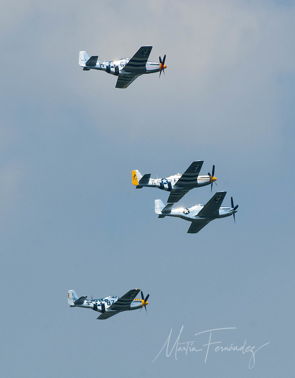 A group of North American P-51 Mustangs make their way toward the Washington Monument during the Arsenal of Democracy flyover.