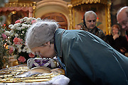 Moscow, Russia, 10/04/2004..Russian Orthodox Easter celebrations at the Church of Peter and Paul in central Moscow. Churchgoers kiss icons inside the church..