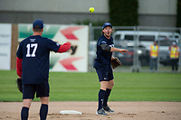 KELOWNA, CANADA - JUNE 28: NHL Nashville Predator Ryan Johansen throws the ball from second base to retired NHL player Scott Hartnell during the opening charity game of the Home Base Slo-Pitch Tournament fundraiser for the Kelowna General Hospital Foundation JoeAnna's House on June 28, 2019 at Elk's Stadium in Kelowna, British Columbia, Canada.  (Photo by Marissa Baecker/Shoot the Breeze)