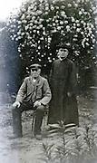 senior man with a priest 1920s
