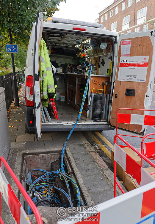 London, United Kingdom - 10 October 2015<br /> Huge drill cuts Virgin fiber cable. Thousand customers without weekend TV and internet. Severed fiber optic cables have caused up to a thousand customers of Virgin Media in Shoreditch and Hackney in London to be left without broadband internet and cable television this weekend. Engineers believe the total loss of service, which continues to be down this Saturday evening, is unlikely to be fixed until Sunday lunchtime at the earliest. The damage to a primary cable carrying 96 fiber optic cables including some belonging to the EE mobile network was caused by a huge drilling rig on a nearby construction site for a block of flats being built by Formation Construction Ltd. An engineer working on the drilling site claimed they had not 'drilled through the cable'. 'We damaged the cable' he said. He then demanded we delete images of the offending drilling rig. Technicians working on behalf of Virgin Media were working hard to replace the damaged cables. Virgin Media press office did not respond to repeated requests to speak with them for comment today.<br /> (photo by: EQUINOXFEATURES.COM)<br /> <br /> Picture Data:<br /> Photographer: Equinox Features<br /> Copyright: ©2015 Equinox Licensing Ltd. +448700 780000<br /> Contact: Equinox Features<br /> Date Taken: 20151010<br /> Time Taken: 17190724<br /> www.newspics.com