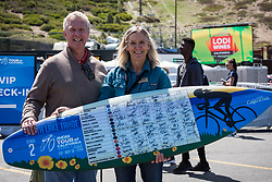 May 18, 2018 - South Lake Tahoe, California, U.S - Friday, May 18, 2018.JAN VANDERMADE (l) of Carson Valley Visitors Authority and CAROL CHAPLIN (r) of Lake Tahoe Visitors Authority, display the day's sign-in surfboard at the start of Stage 2 of the Amgen Tour of California Women's Race empowered with SRAM, which starts and finishes in near Heavenly Ski Resort in South Lake Tahoe, California. (Credit Image: © Tracy Barbutes via ZUMA Wire)