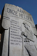 Flemish First World War village memorial to local men, on 25th March, at Saint Martin of Tours Church, in Everberg, Brabant, Belgium.