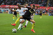 Nicolas Otamendi of Manchester city ® holds off Kyle Naughton of Swansea city.  Premier league match, Swansea city v Manchester city at the Liberty Stadium in Swansea, South Wales on Saturday 24th September 2016.<br /> pic by Andrew Orchard, Andrew Orchard sports photography.