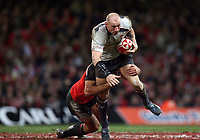 Photo: Rich Eaton.<br /> <br /> Wales v Canada. Invesco Perpetual Series. 17/11/2006. Gareth Thomas captain of Wales with ball in hand is tackled
