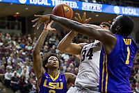LSU forward Duop Reath (1) knocks the ball away from Texas A&M center Tyler Davis (34) during the first half of an NCAA college basketball game Saturday, Jan. 6, 2018, in College Station, Texas. (AP Photo/Sam Craft)