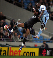 Photo: Paul Thomas.<br /> Manchester City v Chelsea. The Barclays Premiership. 14/03/2007.<br /> <br /> Didier Drogba (L) of Chelsea battles Micah Richards in the air.