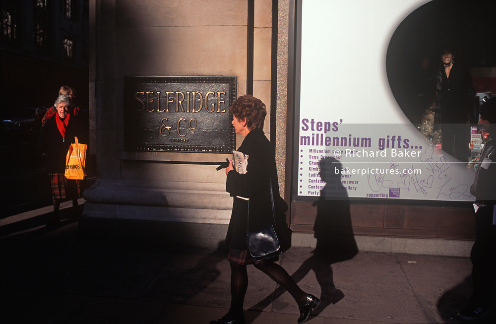 Months before the new Millennium of 2000, women shoppers walk along a sunlit Oxford Street, outside the Selfridge's department store, on 19th September 1999, in London, England.