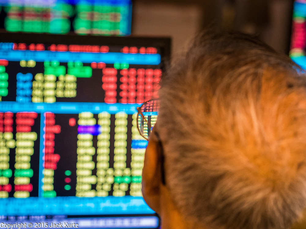 08 JULY 2015 - BANGKOK, THAILAND:  A man watches Thai stocks fall in price at a brokerage house in Bangkok. Thai financial markets and the Thai Baht both lost value Wednesday. The stock market, the Stock Exchange of  Thailand (SET) closed at 1,470.25, down 13.52 or 0.91%, from Tuesday. The Thai Baht closed at 33.90 Baht to 1 US Dollar, it's lowest point since September 2009. Economists blamed the drop in the Chinese stock markets and uncertainty over the EU's handling of the Greek budget crisis for the drops in Thai markets.   PHOTO BY JACK KURTZ