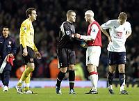 Photo: Olly Greenwood.<br />Arsenal v Tottenham Hotspur. Carling Cup Semi Final 2nd leg 31/01/2007. Arsenal's Manuel Almunia and Philippe Senderos console Spurs Paul Robinson and Michael Dawson