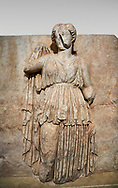 Roman Sebasteion relief sculpture of Ethnos with belted peplos, Aphrodisias Museum, Aphrodisias, Turkey. <br /> <br /> The matronly figure wears a belted classical dress (peplos) and held her long cloak up behind. The square hole above her shoulder with a corresponding hole in the back, was for lifting the finished relief into the ancient building by crane. .<br /> <br /> If you prefer to buy from our ALAMY STOCK LIBRARY page at https://www.alamy.com/portfolio/paul-williams-funkystock/greco-roman-sculptures.html . Type -    Aphrodisias     - into LOWER SEARCH WITHIN GALLERY box - Refine search by adding a subject, place, background colour, museum etc.<br /> <br /> Visit our ROMAN WORLD PHOTO COLLECTIONS for more photos to download or buy as wall art prints https://funkystock.photoshelter.com/gallery-collection/The-Romans-Art-Artefacts-Antiquities-Historic-Sites-Pictures-Images/C0000r2uLJJo9_s0