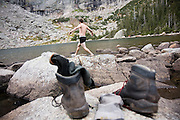 University of Colorado Hiking Club member Graham Goodman goes for a cold swim in Black Lake, Rocky Mountain National Park, Colorado on September 20, 2009.