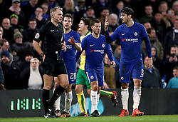 Chelsea's Alvaro Morata (right) makes a gesture towards Referee Graham Scott after receiving a red card