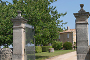 Stone gate posts and iron gate to one of the buildings of Chateau Canon  Saint Emilion  Bordeaux Gironde Aquitaine France