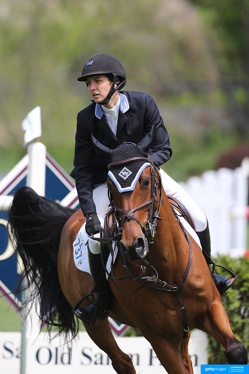 Wesley Newlands riding Lapacco in action during the $35,000 Grand Prix of North Salem presented by Karina Brez Jewelry during the Old Salem Farm Spring Horse Show, North Salem, New York, USA. 15th May 2015. Photo Tim Clayton