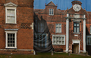 Tromp loeille hiding refurbishments on Christchurch Mansion, a substantial Tudor brick mansion house within Christchurch Park on the edge of the town centre of Ipswich, Suffolk, England.