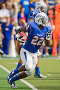 Dec 1, 2012; Tulsa, Ok, USA; Tulsa Hurricanes tailback Trey Watts (22) runs the ball during a game against the University of Central Florida Knights at Skelly Field at H.A. Chapman Stadium. Tulsa defeated UCF 33-27 in overtime to win the CUSA Championship. Mandatory Credit: Beth Hall-USA TODAY Sports