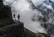 A couple takes a photo at the peak of Huaynapicchu trail.