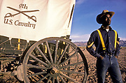 "A group of young juvenile (criminal)  offenders participate in an ""open prison"" rehabilitation programme designed to build self esteem, courage, purposeful lives, seen here  a young offender in a Nevada landscape. They are known as ""Buffalo soldiers"" and use the same clothing as Gral Custer and his cavalry used in the American civil war. Most of  the offenders are black, USA. This programme runs by the name of Vision Quest's Wagon Train."