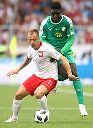 Poland's Kamil Grosicki (left) and Senegal's Ismaila Sarr battle for the ball