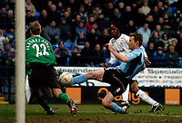 Photo. Jed Wee.<br /> Bolton Wanderers v Fulham, FA Cup 5th Round, 19/02/2005.<br /> Fulham's Brian McBride (R) misses Fulham's best chance to salvage the game.