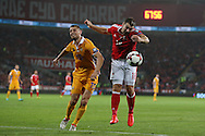 Sam Vokes of Wales ® is challenged by Adrian Cascaval of Moldova. Wales v Moldova , FIFA World Cup qualifier at the Cardiff city Stadium in Cardiff on Monday 5th Sept 2016. pic by Andrew Orchard, Andrew Orchard sports photography
