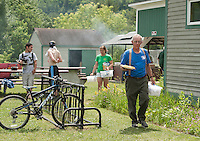 Thaddeus Thresher helps with BBQ lunch preparation for the 70th anniversary celebration for the Kiwanis Pool in St. Johnsbury Vermont.  Karen Bobotas / for Kiwanis International