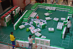 October 13, 2017 - Chongqing, Chongqing, China - A special Mahjong contest is held at a shopping mall in Shenyang, northeast China's Liaoning Province. Attendants should carry giant Mahjong during the contest. (Credit Image: © SIPA Asia via ZUMA Wire)