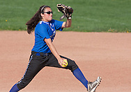 Middletown, New York - A pitcher winds up during a varsity girls' softball game on May 14, 2014.