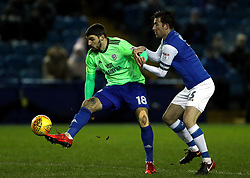 Cardiff City's Callum Paterson (left) and Sheffield Wednesday's David Jones battle for the ball