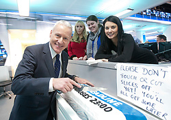 Jim White at the Sky Sports TV studio for the transfer Deadline Day show. Pic cutting the Deadline cake with Natalie Sawyer. .© Michael Schofield.....