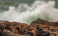 Waves crash into the rocky shoreline at Fanad Head in County Donegal, Ireland