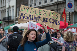 "© Licensed to London News Pictures . 20/06/2015 . London , UK . A woman with "" Dyslexics Against the Cunts "" banner in Parliament Square . Tens of thousands of people march from the Bank of England to Parliament , to protest economic austerity in Britain . Photo credit: Joel Goodman/LNP"