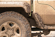 Close-up detail of a dirty safari car covered in mud, Ngorongoro Conservation Area, Tanzania