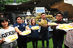 June 10, 2017 - Bangkok - Competitors pose for photo ahead of a durian eating competition held at a shopping mall in Bangkok, Thailand. The goal is to finish eating one kilogram of durian in as little time as possible. (Credit Image: © Rachen Sageamsak/Xinhua via ZUMA Wire)