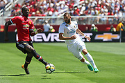 Manchester United Defender Eric Bailly battles with Real Madrid Forward Karim Benzema during the AON Tour 2017 match between Real Madrid and Manchester United at the Levi's Stadium, Santa Clara, USA on 23 July 2017.