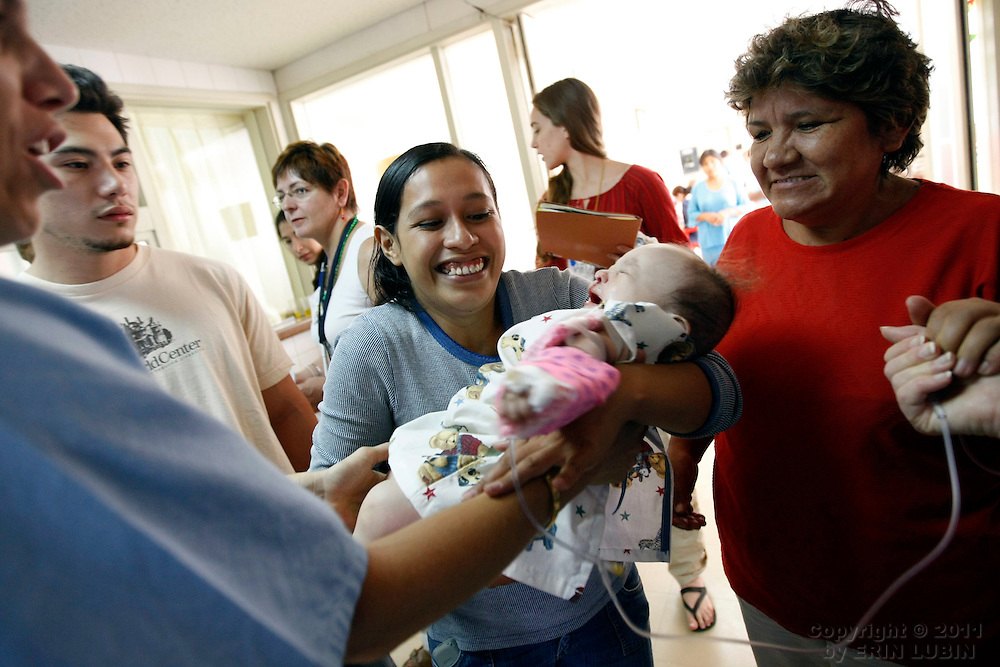 Seven month old Rodrigo Siles of Santa Cruz, is handed back to his mother after undergoing surgery with Operation Smile Thursday morning, November 15, 2007, at the Hospital Japones in Santa Cruz, Bolivia during Operation Smile's World Journey of Smiles...Photograph by Erin Lubin