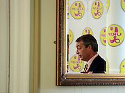 © Licensed to London News Pictures. 26/04/2012. London, UK . Nigel Farage MEP and leader of UKIP reflected in a mirror. The UK Independence Party (UKIP) local election campaign launch at St Stephen's Club, Central London. Photo credit : Stephen Simpson/LNP