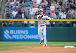May 13, 2018 - Denver, CO, U.S. - DENVER, CO - MAY 13: Colorado Rockies infielder Trevor Story (27) fields a ground ball and throws to first base during a regular season MLB game between the Colorado Rockies and the visiting Milwaukee Brewers on May 13, 2018 at Coors Field in Denver, CO. (Photo by Russell Lansford/Icon Sportswire) (Credit Image: © Russell Lansford/Icon SMI via ZUMA Press)