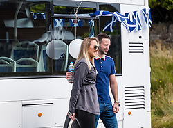 Josh Taylor victory tour, Prestonpans, East Lothian, Scotland, United Kingdom 27 June 2021: <br /> Prestonpans born world boxing champion Josh Taylor greets his fans from an open top white double decker bus in a victory lap around the town. Josh Taylor became the first  British boxer world champion in the four-belt era after defeating Jose Ramirez last month. Pictured: Josh and his fiancée Danielle Murphy.<br /> Sally Anderson   EdinburghElitemedia.co.uk